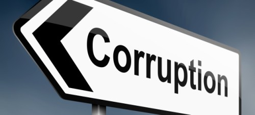 Corruption-Arrow-Sign1-630x286